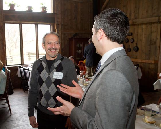 SAM HOUSEHOLDER | THE GOSHEN NEWS<br /> Arden Graber, of Graber's Flooring, left, talks with Gavin Miller, of Lake City Bank during the Nappanee Chamber of Commerce Annual Appreciation Dinner.