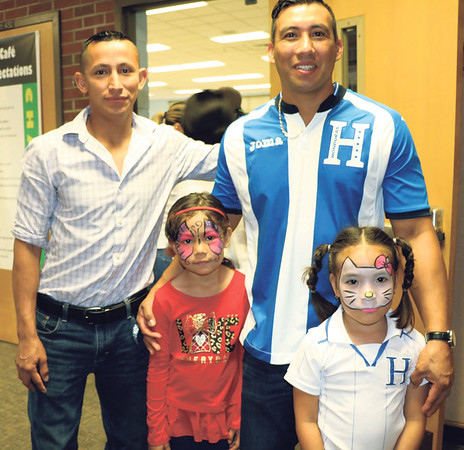 SHERRY VAN ARSDALL | THE GOSHEN NEWS At left, Raul Carbajar and his daughter, Lucy, and Nelson Rodas and his daughter, Janie, attended an Hispanic Heritage Celebration at Chandler Elementary School Saturday.