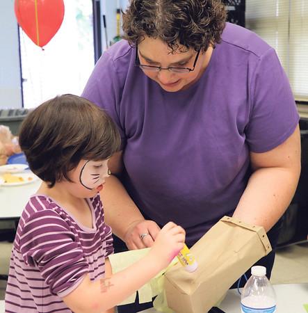 SHERRY VAN ARSDALL   THE GOSHEN NEWS Kindergartner Ella Shank VanEenige and her mother, Nadia Shank VanEenige make a pinata during an Hispanic Heritage Celebration at Chandler Elementary School Saturday.