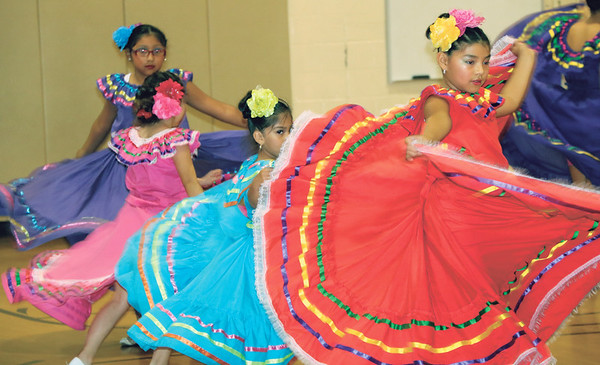 SHERRY VAN ARSDALL | THE GOSHEN NEWS A group of students from St. John the Evangelist Catholic School perform during an Hispanic Heritage Celebration at Chandler Elementary School Saturday.