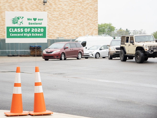 Concord seniors wait outside in their vehicles to walk the stage at Concord High School during graduation Monday morning.