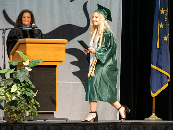Concord Senior salutatorian Stephanie Lauren Rowe walks the stage at Concord High School during graduation Monday morning.