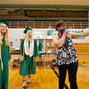 Concord principle secretary Heather Bohen, right, directs  Concord Senior valedictorian Rachel Taylor Rowe, left, and salutatorian Stephanie Lauren Rowe, center, to the stage at Concord High School during graduation Monday morning.