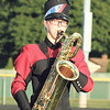 STACEY DIAMOND | THE GOSHEN NEWS<br /> Baritone sax player Cari Patterson performs with the NorthWood Marching Chargers Saturday during the marching band invitational at Concord High School.