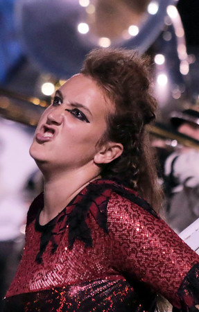 STACEY DIAMOND | THE GOSHEN NEWS<br /> A Northridge Marching Raiders color guard member performs Saturday during the marching band invitational at Concord High School.