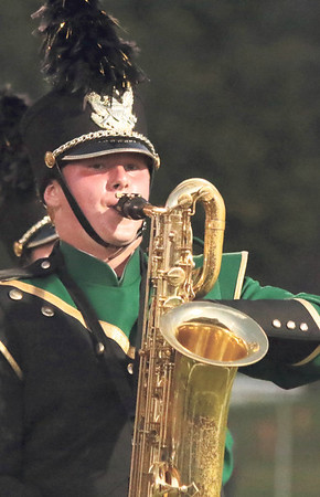 STACEY DIAMOND | THE GOSHEN NEWS<br /> Baritone sax player Cody Walker performs with the Wawasee Marching Warrior Pride during the marching band invitational Saturday at Concord High School.