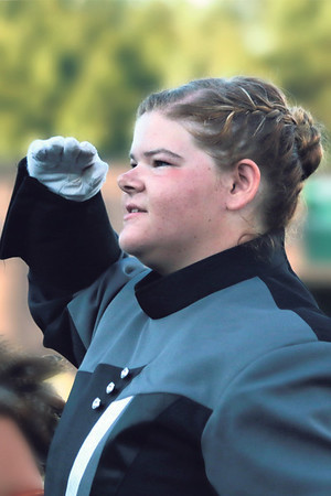 STACEY DIAMOND | THE GOSHEN NEWS<br /> NorthWood Marching Chargers drum major Linnea Bendes salutes the crowd after the NorthWood High School band received first place in Class C Saturday during the marching band invitational at Concord High School.