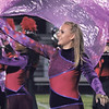 STACEY DIAMOND | THE GOSHEN NEWS<br /> Goshen High School color guard member Carrie O'Dell performs Saturday during the marching band invitational at Concord High School.