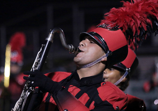 STACEY DIAMOND | THE GOSHEN NEWS<br /> A bass clarinet player from Goshen High School performs Saturday during the marching band invitational at Concord High School.