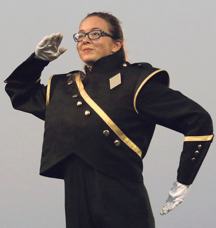 STACEY DIAMOND | THE GOSHEN NEWS<br /> Wawasee Marching Warrior Pride drum major signals performers during Saturday's marching band invitational at Concord High School.