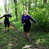 SHERRY VAN ARSDALL | THE GOSHEN NEWS<br /> At left, Courtney Huston of Syracuse and Annie Byler of Goshen work their way through a wire tangle at The Cops for Kaleb 5K obstacle run held Saturday at Cop'er Canyon in Bristol. The event was a fundraiser for 3-year-old Kaleb Cole, the only child in Indiana who was born with Leigh's disease. He is the son of Michael and Krysta Cole. Michael is a sergeant with the Elkhart County Sheriff's Department.