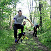 SHERRY VAN ARSDALL | THE GOSHEN NEWS<br /> Participants in the Cops for Kaleb 5K obstacle run make their way through the course at Cop'er Canyon in Bristol. The event was a fundraiser for 3-year-old Kaleb Cole, the only child in Indiana who was born with Leigh's disease. He is the son of Michael and Krysta Cole. Michael is a sergeant with the Elkhart County Sheriff's Department. <br /> From left, Brandon Denesuk, Matt Walsh and Chuck Osterday are all detectives with ECSD.
