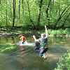 SHERRY VAN ARSDALL | THE GOSHEN NEWS<br /> Particpants plunge into the river cross during The Cops for Kaleb 5K obstacle run was held Saturday at Cop'er Canyon in Bristol. The event was a fundraiser for3-yearr-old Kaleb Cole, the only child in Indiana who was born with Leigh's disease. He is the son of Michael and Krysta Cole. Michael is a sergeant with the Elkhart County Sheriff's Department.