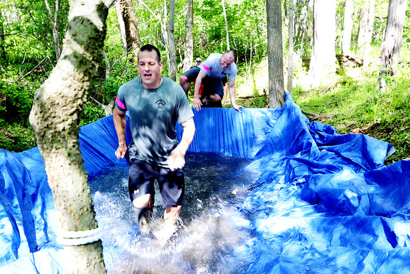 SHERRY VAN ARSDALL | THE GOSHEN NEWS<br /> Particpants run through the ice pit during The Cops for Kaleb 5K obstacle run held Saturday at Cop'er Canyon in Bristol. The event was a fundraiser for 3-year-old Kaleb Cole, the only child in Indiana who was born with Leigh's disease. He is the son of Michael and Krysta Cole. Michael is a sergeant with the Elkhart County Sheriff's Department.