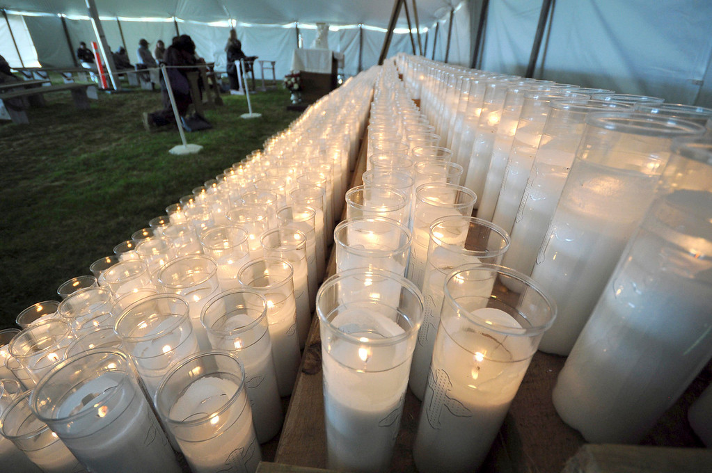 . Hundreds of candles illuminate and warm the tent where worshipers could go for silent time at the Divine Mercy Sunday weekend on Sunday, April, 27, 2014 in Stockbridge. Gillian Jones / Berkshire Eagle Staff / photos.berkshireeagle.com