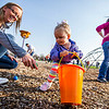 JAY YOUNG | THE GOSHEN NEWS<br /> Two-year-old Sophia Whitehead, of Goshen, gets help from mom, Ashley, as they collect eggs during an Easter egg hunt Saturday morning at New Paris Elementary School. The egg hunt was sponsored by the New Paris Lions Club and contained 4,000 eggs.