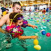 JAY YOUNG | THE GOSHEN NEWS<br /> Manuel Carranza, of Goshen, guides his three-year-old daughter, Gabriella Mooke, towards a group of eggs as they participate in the second annual Easter egg hunt at Shepard Swim School in Elkhart.