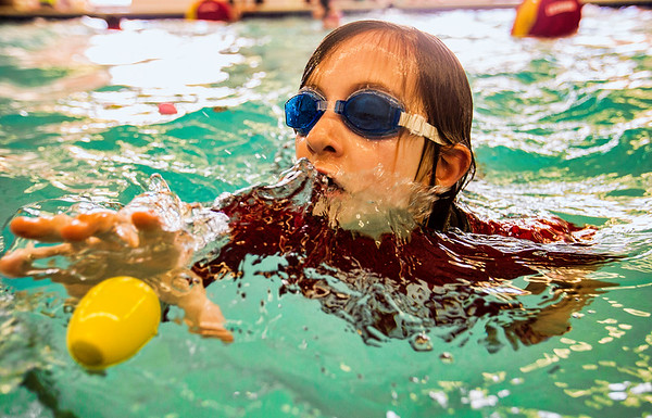 JAY YOUNG | THE GOSHEN NEWS<br /> Eight-year-old Liam Wiles-Smith emerges from under the water to pluck an egg during the second annual Easter egg hunt at Shepard Swim School in Elkhart.