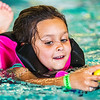 JAY YOUNG | THE GOSHEN NEWS<br /> Six-year-old Natalie Weaver, of Goshen, reaches for an egg as she swims during the second annual Easter egg hunt at Shepard Swim School in Elkhart.