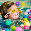 JAY YOUNG | THE GOSHEN NEWS<br /> Five-year-old Evelyn Wiles-Smith is surrounded by a bunch of colorful plastic eggs as she swims during the second annual Easter egg hunt at Shepard Swim School in Elkhart.