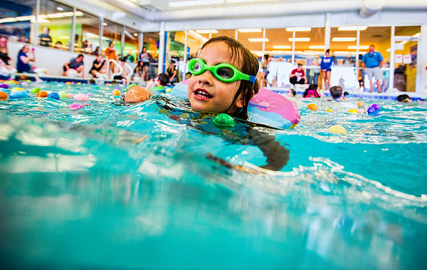 JAY YOUNG | THE GOSHEN NEWS<br /> Four-year-old Lauren Fletcher, of Granger, makes waves while making her way to her basket to drop off an egg during the second annual Easter egg hunt at Shepard Swim School in Elkhart.