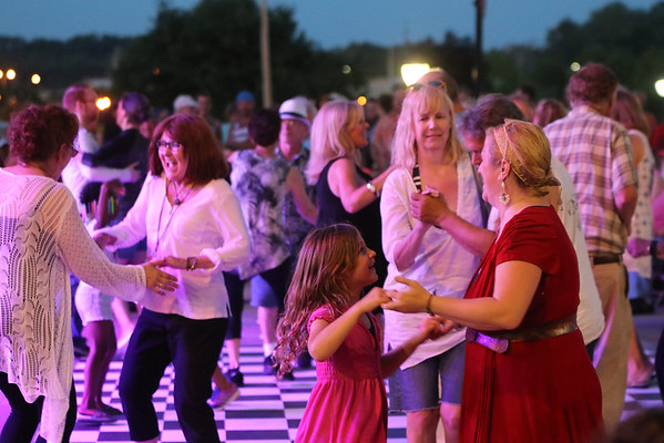GEOFF LESAR | THE GOSHEN NEWS<br /> <br /> Crowd members dance to music of Dave Bennett's tribute to Jerry Lee Lewis Saturday at the Elkhart Jazz Festival in the city's Civic Plaza.