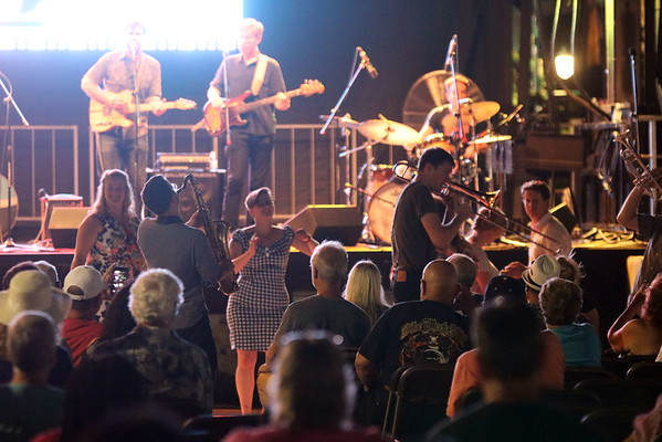 GEOFF LESAR   THE GOSHEN NEWS<br /> <br /> The brass section of The Rad Trads stepped off stage and into the crowd Saturday evening at the Elkhart Jazz Festival in the city's Civic Plaza.