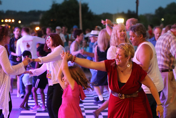 GEOFF LESAR   THE GOSHEN NEWS<br /> <br /> Crowd members dance to music of Dave Bennett's tribute to Jerry Lee Lewis Saturday at the Elkhart Jazz Festival in the city's Civic Plaza.