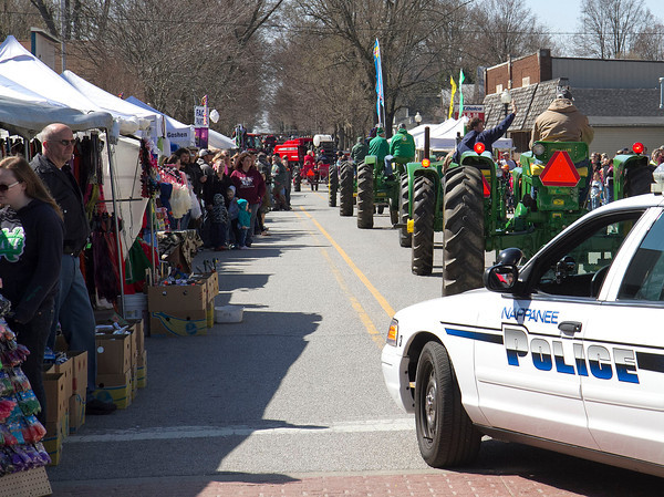 SAM HOUSEHOLDER | THE GOSHEN NEWS<br /> The Wakarusa Maple Syrup Festival parade makes its way up Elkhart Street Saturday. The annual event will end today, the first time it's lasted three days, according to organizers.