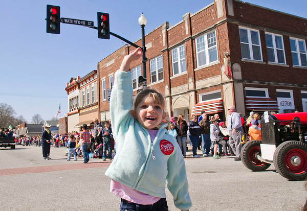 SAM HOUSEHOLDER | THE GOSHEN NEWS<br /> Kayleanna Moser, 5, of Breman holds up a piece of candy she received during the Maple Syrup Festival Parade in Wakarusa Saturday.