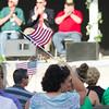 SAM HOUSEHOLDER | THE GOSHEN NEWS<br /> Gina Willard, Millersburg, waves a flag during the veteran's program at the Elkhart County 4-H Fair Friday. Friday was Veteran's Day at the fair and honored the veteran's with a program.