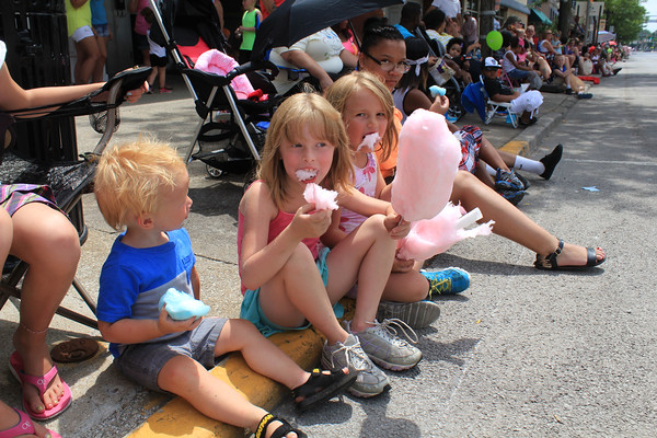 ROGER SCHNEIDER | THE GOSHEN NEWS Jonavan Phillips, 2 with siblings Samantha, 7 and Brittnee, 5 enjoy cotton candy before the fair parade started Sunday.