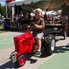 SAM HOUSEHOLDR| THE GOSHEN NEWS<br /> Tanner McKay, 3, enjoys his turn during the Pedal Power Tractor Pull Thursday at the Elkhart County 4-H Fair.