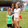 Preston Ryan, 6, Meg Ryan and  Sydney Briggs, all of Goshen