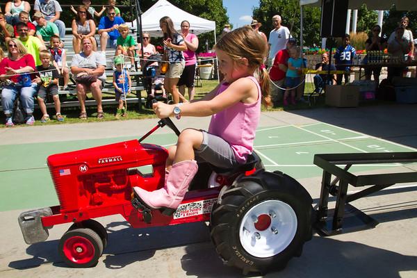SAM HOUSEHOLDER   THE GOSHEN NEWS<br /> Hadley Yoder, 4, Shipshewana, participates in the Pedal Power Tractor Pull at the Elkhart County 4-H Fair Thursday in Goshen.