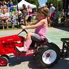 SAM HOUSEHOLDER | THE GOSHEN NEWS<br /> Hadley Yoder, 4, Shipshewana, participates in the Pedal Power Tractor Pull at the Elkhart County 4-H Fair Thursday in Goshen.