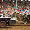 SAM HOUSEHOLDER | THE GOSHEN NEWS<br /> A car gets airbourne after being struck by a competitor's car Saturday night during the demolition debry at the Elkhart County 4-H Fair.