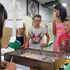 JULIE CROTHERS BEER | THE GOSHEN NEWS<br /> With help from her siblings, Brielle Nafziger, 10, center, drops off her Entomology project Monday afternoon at the Elkhart County 4-H Fairgrounds. Pictured with her are her sister Jazelyn, 7, mom Lael and brother Bryce, 8. Also attending project check in was her younger sister Alora, 5, not pictured. Project check in took place from 11 a.m. to 7 p.m. Monday with all ages stopping by the fairgrounds to drop off their completed projects. The projected will be judged and ribbons awarded in the coming days leading up to the start of the 2016 fair Friday.