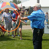 SHERRY VAN ARSDALL | THE GOSHEN NEWS<br /> Elizabeth Higginbotham throws a football in the Special Olympics skill events during Disability Awaremenss Day Monday at the Elkhart County 4-H Fair.