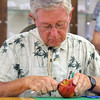 JULIE CROTHERS | THE GOSHEN NEWS<br /> <br /> Ned Miller, of Goshen, begins the process of peeling his apple during Tuesday's competition at the Elkhart County 4-H Fair. First place went to Stacey Thorpe, of Fort Wayne, whose apple peel was 82 and 1/2 inches long.