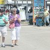 JULIE CROTHERS | THE GOSHEN NEWS<br /> <br /> Dave and Shirley Nicoson, of Goshen, enjoy ice cream Tuesday while walking around the Elkhart County 4-H Fair. The Nicosons visit the fair for Senior Citizen Day each year.