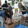 "SHERRY VAN ARSDALL | THE GOSHEN NEWS<br /> Some of the volunteers taking part in the Elkhart County 4-H Fair ""All IN"" food drive for attempting a ""Guinness Book of World Records"" for the largest single-day food drive."