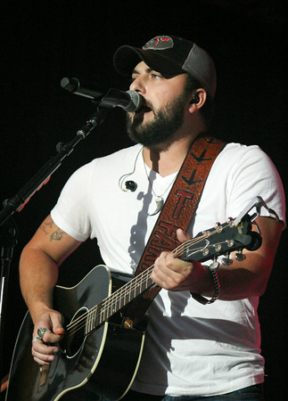 JULIE CROTHERS | THE GOSHEN NEWS<br /> Country music star Tyler Farr performs for fans during at the main grandstand during the Elkhart County 4-H Fair Monday evening.