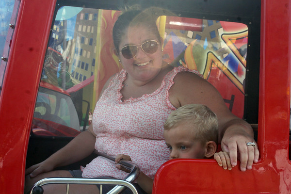 SHERRY VAN ARSDALL | THE GOSHEN NEWS<br /> Lucas Molnar, 3, and his mom, Jordan Molnar, enjoy the Firehouse amusement ride during Disability Awaremenss Day Monday at the Elkhart County 4-H Fair.