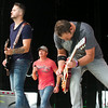 SAM HOUSEHOLDER | THE GOSHEN NEWS<br /> Brad Arnold, center, lead singer of 3 Doors Down performs with bandmates Chet Roberts, right, and Justin Biltonen, left at the Elkhart County 4-H Fair Saturday.