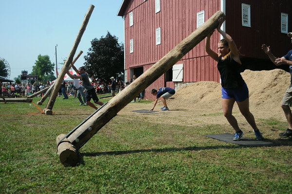 JULIE CROTHERS | THE GOSHEN NEWS<br /> Mindi Fisher, of Bristol, competes in the log flip event during Saturday's Strongman Competition at the Elkhart County 4-H Fair. Participants were required to flip the log six times in two minutes.