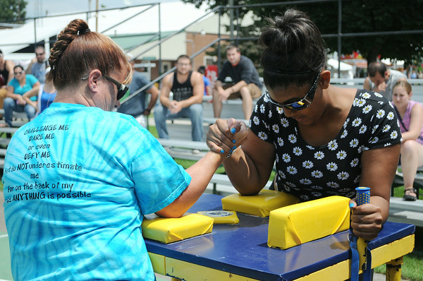 JULIE CROTHERS | THE GOSHEN NEWS<br /> Reigning women's arm wrestling champion Shyla Southern, right, competes against Jean Smith Saturday at the Elkhart County 4-H Fair. Southern came in first in the women's division of arm wrestling and Smith was second.