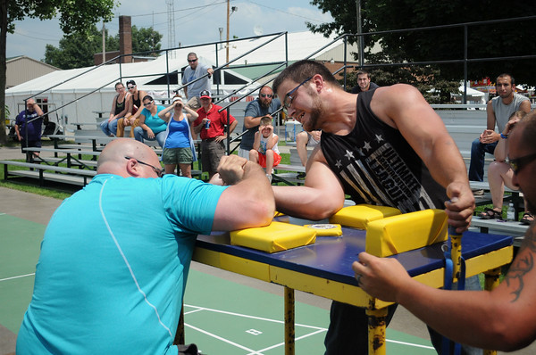 JULIE CROTHERS | THE GOSHEN NEWS<br /> Josh Moore, at left, competes against Ferris Durik during Saturday's arm wrestling competition at the Elkhart County 4-H Fair. Moore won the 210 pound or more division and Durik placed second.