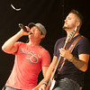 SAM HOUSEHOLDER | THE GOSHEN NEWS<br /> The rock band 3 Doors Down performs on the grandstand stage the Elkhart County 4-H Fair Saturday in Goshen. Lead singer Brad Arnold, left and bassist Justin Biltonen are shown.