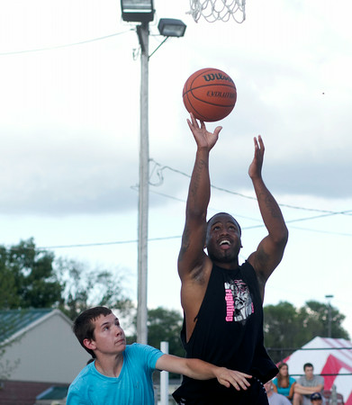SAM HOUSEHOLDER | THE GOSHEN NEWS<br /> Sean Cooper, Elkhart, shoots the ball over Noah Vollmar, Elkhart during the three on three basketball tournament Wednesday at the Elkhart County 4-H Fair.